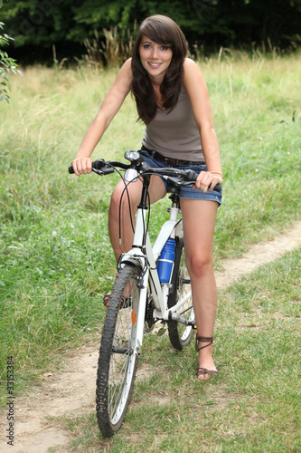 young woman doing mountain bike in the country