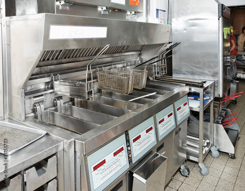 Tuinposter Koken Deep fryer on restaurant kitchen
