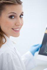 Smiling woman in lab coat