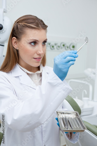 Dentist holding dentist's mirror