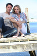 Couple sitting on the pier