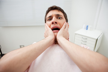 Patient in dentist's office afraid of treatment