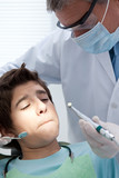Boy refusing dental treatment
