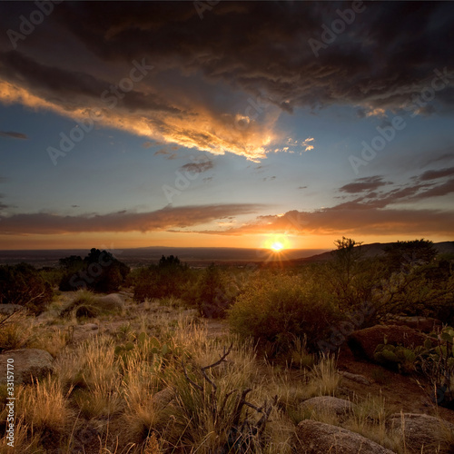 Fotobehang Woestijn Desert Scenics: Stormy Sunset