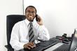 Happy businessman working at desk smiling