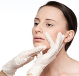 Beautician touch and exam health woman face. poster