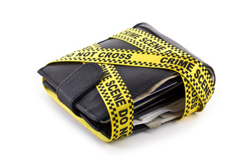 Wallet closed and wrapped in crime scene tape isolated