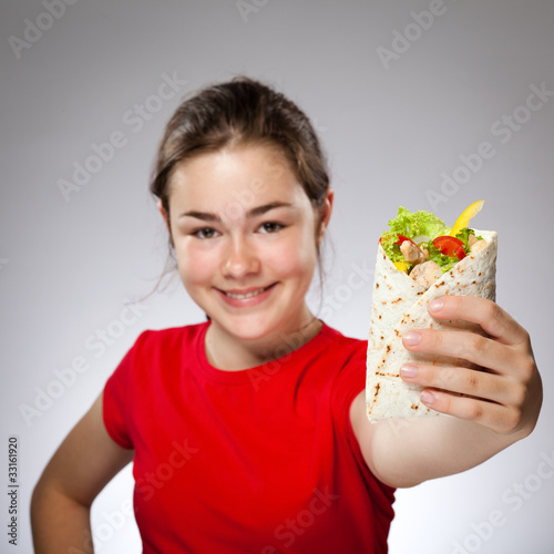 Girl eating big sandwich