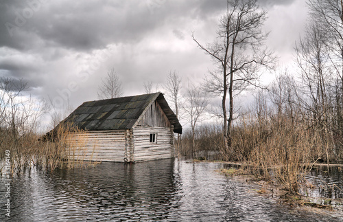 old wooden house in water - 33164149