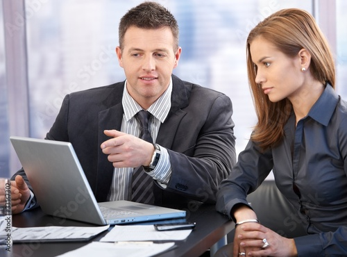 Attractive businesspeople having discussion