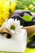 Spa,  flower on the towel, and a bowl with black stones