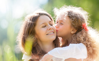 daugher kissing her mother
