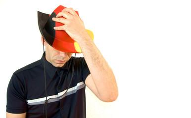 Mann mit Deutschland Hut