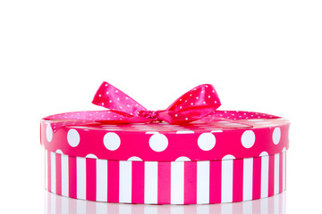 a pink dotted striped giftbox with a bow isolated over white