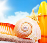 Beach items over blue sky poster