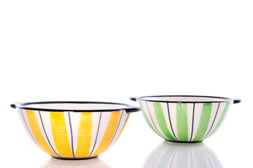 two colorful striped dishes isolated over white background