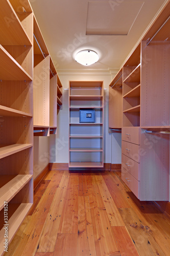 Large Empty walk-in closet with a safe
