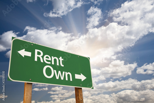 Rent, Own Green Road Sign Against Clouds