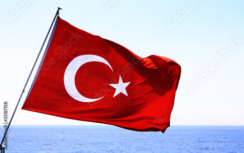 Image of Turkish flag over sea