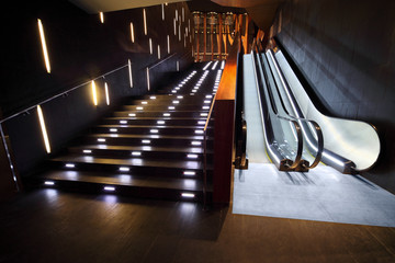 Luxurious interior from modern materials with escalator