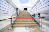 Enclosure on marble staircase which conducts on first floor poster