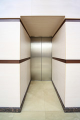One lift with closed metallic doors
