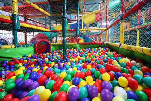 Much varicoloured bright balls are poured in sector for slide