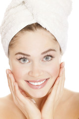 Beautiful young woman face with white towel on the head
