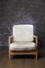 white chair in studio of photographer, brown background