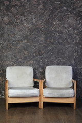 white chairs in studio of photographer, brown background