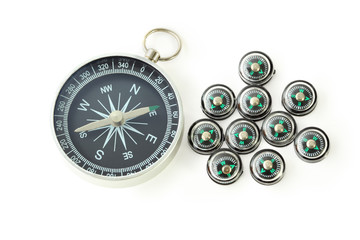 big compass with ten black small compasses isolated
