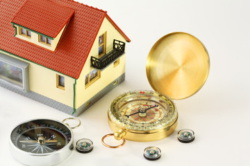 toy house and seven different compasses isolated