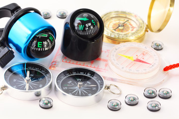 Fifteen different multi-colored compasses