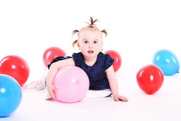 little girl plays with color balloons