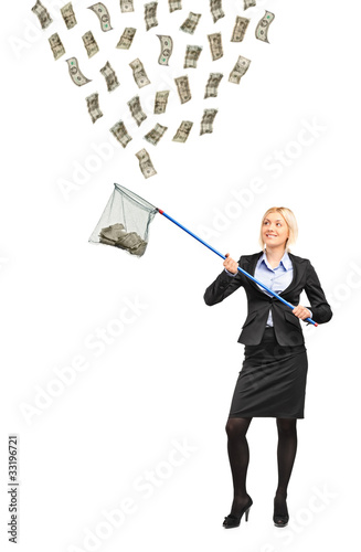 Businesswoman with a fishing net trying to catch money