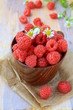 fresh ripe raspberries still life in a rustic style