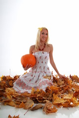 Autum girl with a pumpkin
