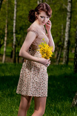 brunette girl in spring forest with flowers