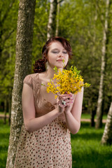 portrait of young cute female with yellow flowers