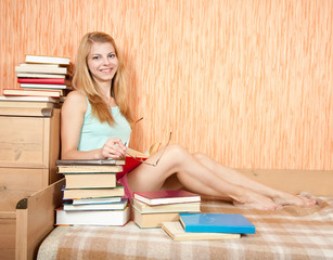 smiling woman with books