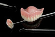 denture, instruments, black background