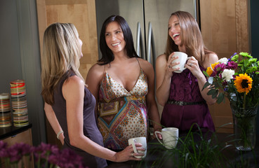 Smiling pregnant women with friends
