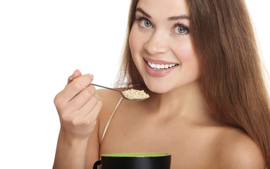 portrait of young caucasian woman eating cereals