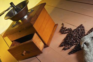 Vintage coffee grinder and coffee beans