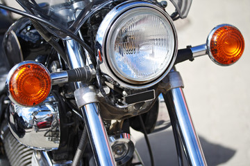 Part of motorcycle – headlight. Detail of Motorbike. Outdoors