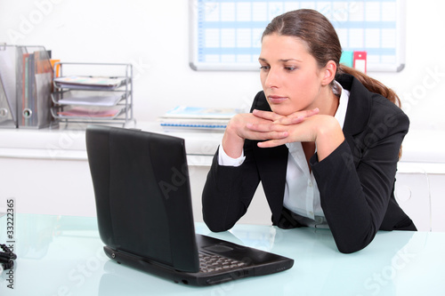 Brunette businesswoman bored at work