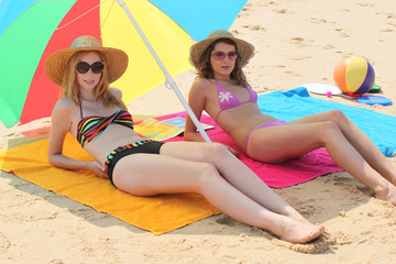 Girls lying on the beach