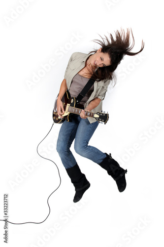 Girl rocking the guitar