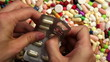Person pressing pills out of container