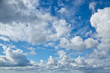 Blue sky with cumulus clouds background